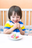 Happy child with lollipops of playdough and toothpicks Royalty Free Stock Photography
