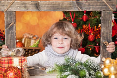 Happy child looking into wooden frame Stock Image