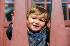 A happy child looks and smiles Stock Image