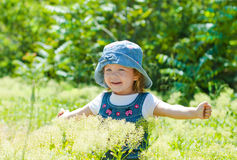 Happy child in a lush field Stock Photography