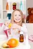 Happy child making lemon juice Royalty Free Stock Photos