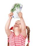 Happy child with money euro. Stock Photo