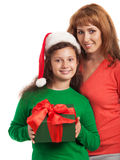 Happy child and mother with Christmas gift Royalty Free Stock Photos