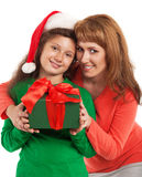 Happy child and mother with Christmas gift Royalty Free Stock Photography