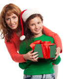 Happy child and mother with Christmas gift Royalty Free Stock Images