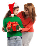 Happy child and mother with Christmas gift Stock Image