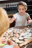 Happy child with mother making  dumplings Royalty Free Stock Photos