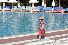 Happy child next to swimming pool Stock Photos