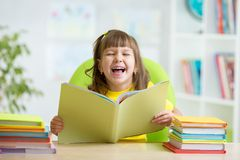 Happy child with opened book Royalty Free Stock Photography