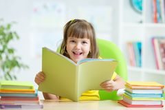 Happy child with opened book Stock Image