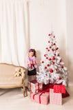 Happy child opening Christmas gift box stock photos