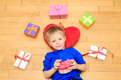 Happy child opening presents at family holiday Royalty Free Stock Photography