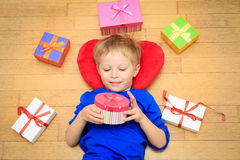 Happy child opening presents at family holiday Stock Images
