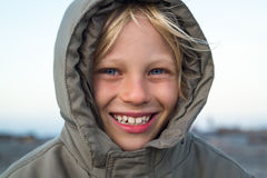 Happy child outdoors in warm jacket Stock Photo