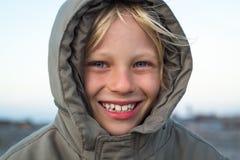 Happy child outdoors in warm jacket. Happy, handsome child outdoors in warm thick jacket Stock Photo