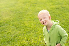 Happy child over green grass Stock Photos