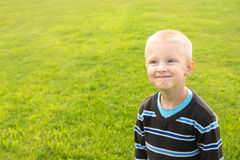Happy child over green grass Royalty Free Stock Images