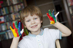 Happy child with painted hands Royalty Free Stock Photos