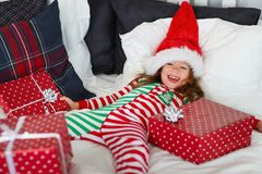 Happy child in pajamas with gifts on christmas morning near chr royalty free stock photo