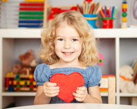 Happy child with paper heart Stock Image