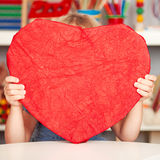 Happy child with paper heart Stock Images