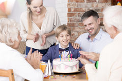 Happy child with parents Stock Image