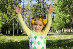 Happy child in park with hands up Royalty Free Stock Image