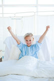 Happy child patient punching the air Stock Photo