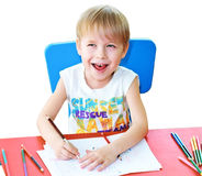 Happy child with pencils Royalty Free Stock Photography