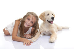 Happy child with pet puppy dog Stock Photo