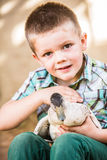 Happy Child Petting Duck Royalty Free Stock Images