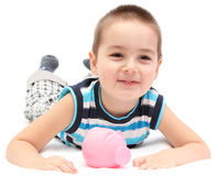 Happy child with piggy bank Stock Photos