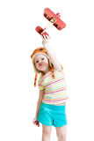 Happy child pilot and playing with wooden airplane. Happy child girl dressed pilot and playing with wooden airplane toy Stock Photo