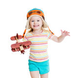 Happy child pilot and playing with wooden airplane Stock Photos