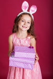 Happy child with pink christmas gift boxes Stock Photography