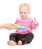 Happy child in pink jacket and trousers draws Royalty Free Stock Images