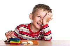 Happy child with plasticine Royalty Free Stock Photos