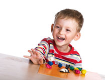 Happy child with plasticine Stock Photos