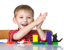 Happy child with plasticine Royalty Free Stock Photography