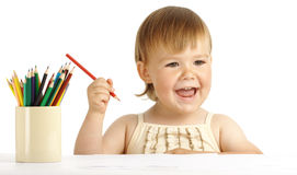 Happy child play with color pencils and smile Royalty Free Stock Photography