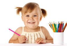 Happy child play with crayons and smile Royalty Free Stock Photos