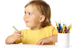Happy child play with crayons and smile Stock Photo