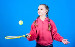 Happy child play tennis in gym staduim. Sport game success. Tennis player with racket and ball. Childhood activity. Little girl. Fitness diet bring health and royalty free stock photography