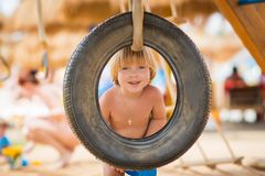 Happy child on the playbround stock photo