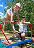 Happy child on playground outdoor, play in city park, summer season, bright sunlight Royalty Free Stock Photo
