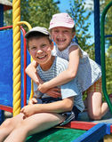 Happy child on playground outdoor, play in city park, summer season, bright sunlight Royalty Free Stock Image