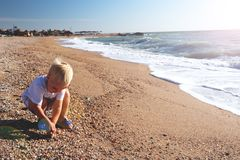 Happy child playing on the beach stock photo