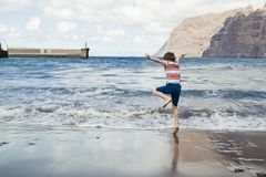 Happy child playing on beach. Royalty Free Stock Image