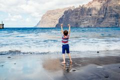 Happy child playing on beach. Stock Photography