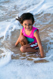 Happy child playing on the beach Royalty Free Stock Photo